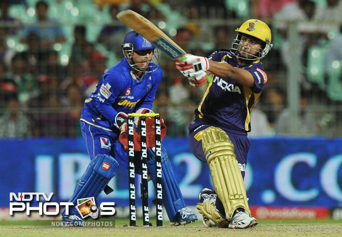 Kolkata Knight Riders batsman Shakib Al Hasan is watched by Rajasthan Royals wicketkeeper Shreevats Goswami as he plays a shot during the IPL Twenty20 cricket at the Eden Gardens in Kolkata. (AFP PHOTO/Dibyangshu SARKAR)