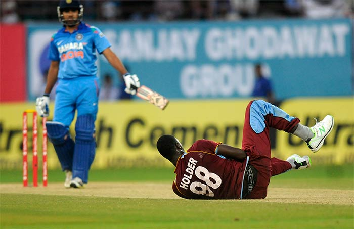 In reply, India lost Shikhar Dhawan early but the other opener in Rohit Sharma (left) kept the West Indies' bowlers at bay.