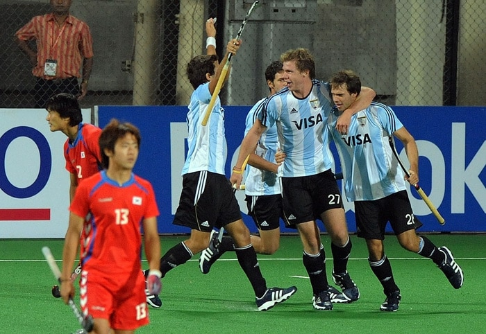 Argentinian hockey players Facundo Callioni and Lucas Rafael Rossi celebrate a goal against South Korea with teammates during their World Cup 2010 match at the Major Dhyan Chand Stadium. (AFP Photo)