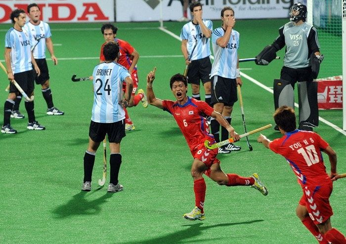 South Korean hockey player Lee Nam Yong celebrates a goal against Argentina during their World Cup 2010 match at the Major Dhyan Chand Stadium in New Delhi. (AFP Photo)