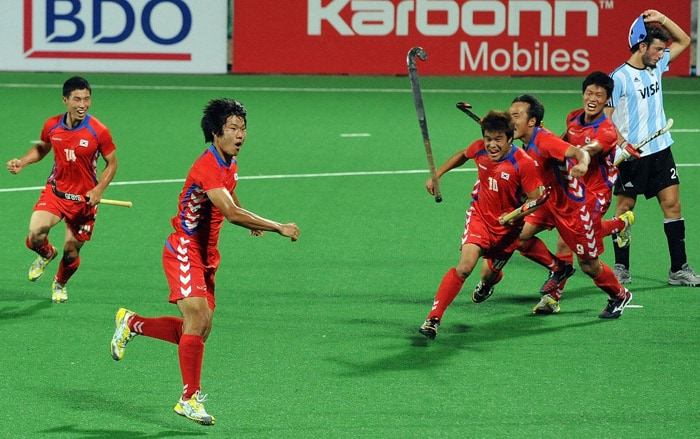 South Korean hockey player Nam Hyun Woo throws his hockey stick in jubilation after scoring a goal against Argentina during their World Cup 2010 match at the Major Dhyan Chand Stadium in New Delhi. South Korea won the match against Argentina by 2-1. (AFP Photo)