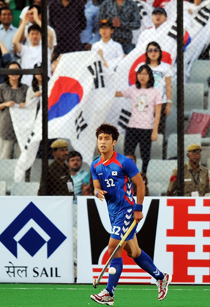 South Korean hockey player Jang Jong Hyun celebrates scoring a goal against Canada during their World Cup 2010 match at the Major Dhyan Chand Stadium in New Delhi. (AFP Photo)