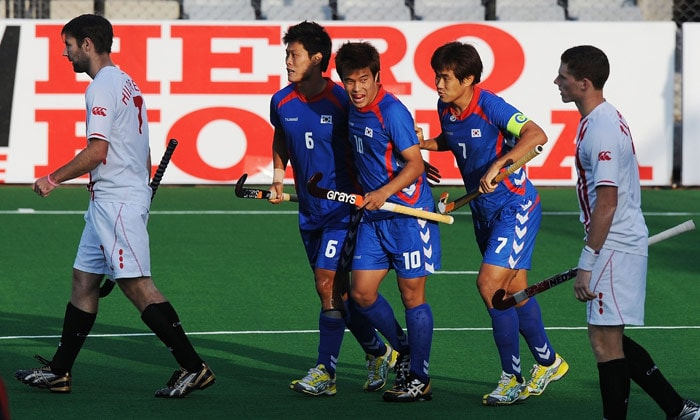 South Korean hockey player You Hyo Sik (C) celebrates with teammates after scoring a goal against Canada during their World Cup 2010 match at the Major Dhyan Chand Stadium in New Delhi. (AFP Photo)