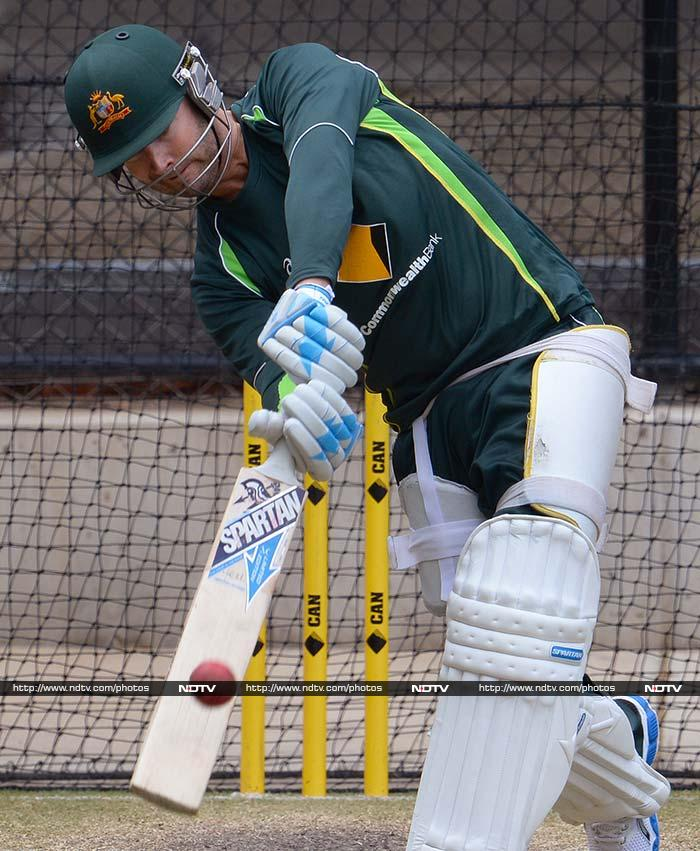 Michael Clarke, despite an ankle strain and back issues, seems fit enough to smash the ball around in the nets. (AFP image)