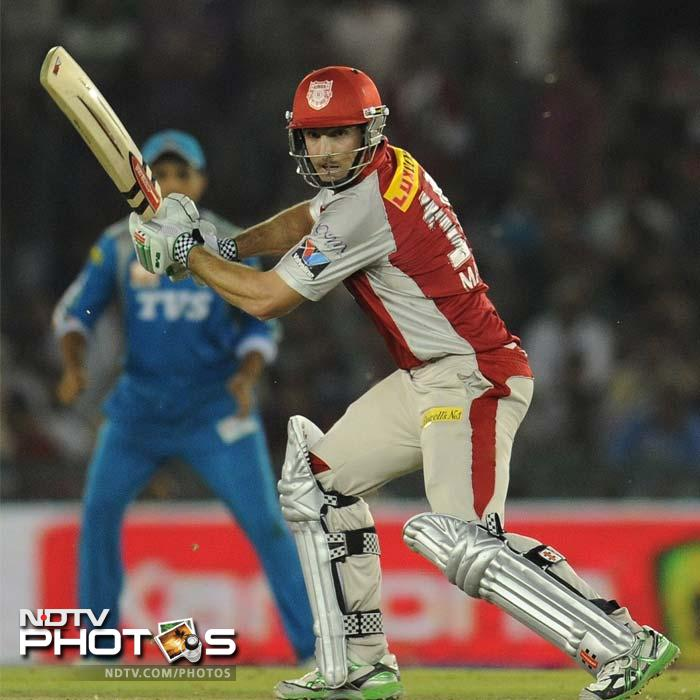 Shaun Marsh led the chase of 116 with an unbeaten 64 after Dimitri Mascarenhas took 5 wickets as Kings XI Punjab defeated Pune Warriors by 7 wickets. (AFP PHOTO/Prakash SINGH)