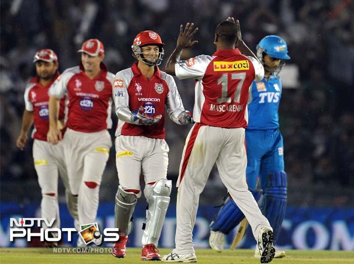 Kings XI Punjab wicketkeeper and captain Adam Gilchrist (C) celebrates the wicket of Pune Warriors batsman Sourav Ganguly (R) with bowler Dimitri Mascarenhas (2R) during the IPL Twenty20 cricket match at the PCA Stadium in Mohali. (AFP PHOTO/Prakash SINGH)