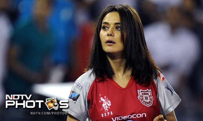 Kings XI Punjab team owner and Bollywood actress Preity Zinta at her team's IPL Twenty20 cricket match against Pune Warriors at PCA Stadium in Mohali. (AFP PHOTO/Prakash SINGH)