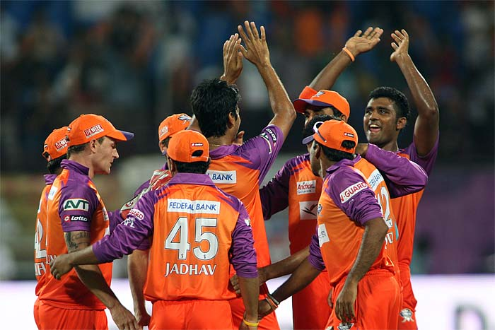 Kochi Tuskers Kerala players celebrate after RP Singh struck early to remove Deccan Chargers opener Shikhar Dhawan during an Indian Premier League cricket match in Kochi. (AFP Photo)