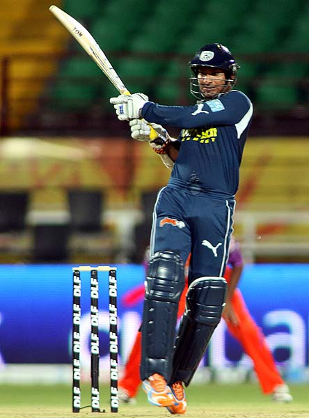 Deccan Chargers skipper Kumar Sangakkara makes the most of the reprieve by hitting a half-century in the Indian Premier league match against Kochi Tuskers Kerala at Kochi. (AFP Photo)