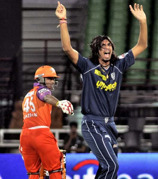 Deccan Chargers' Ishant Sharma, who took a 5-wicket haul, celebrates the wicket of Kochi Tuskers Kerala's Brad Hogg, during the Indian Premier League cricket match in Kochi. (AP Photo)
