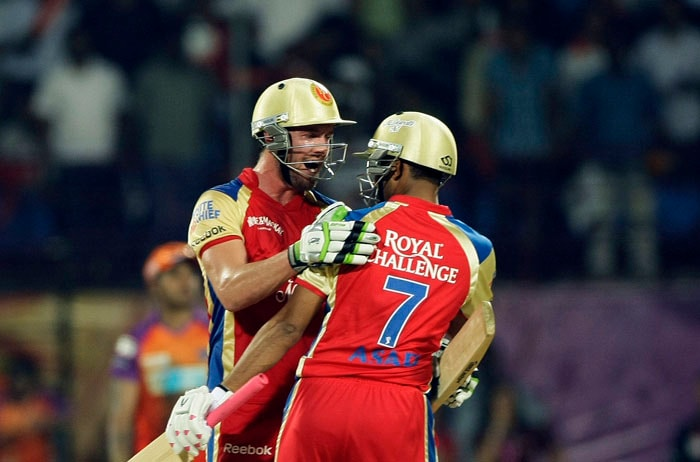 Royal Challengers Bangalore's AB De Villiers, facing the camera, reacts with teammate Asad Khan Pathan after winning the Indian Premier League match against Kochi Tuskers Kerala in Kochi. (AP Photo)