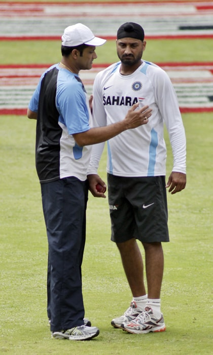 Kumble was recently appointed chairman of the National Cricket Academy and the Chinnaswamy Stadium in Bangalore is his home ground. Here he is seen helping his former teammate Harbhajan Singh. (AP Photo)