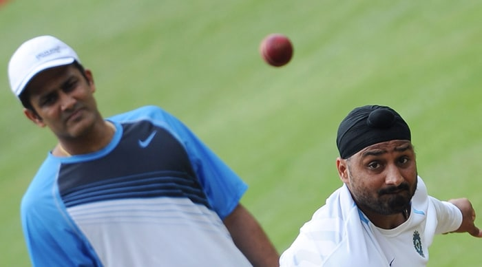 Harbhajan continues to toil in the nets under the watchful eyes of Anil Kumble. (AFP PHOTO)