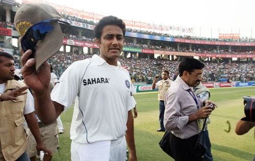 Anil Kumble waves his cap on his announcement of his retirement from Test cricket in New Delhi.
