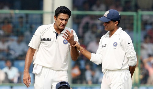Sourav Ganguly looks at the bleeding finger of Anil Kumble, injured while fielding, during the third Test match between Indian and Australia in New Delhi.