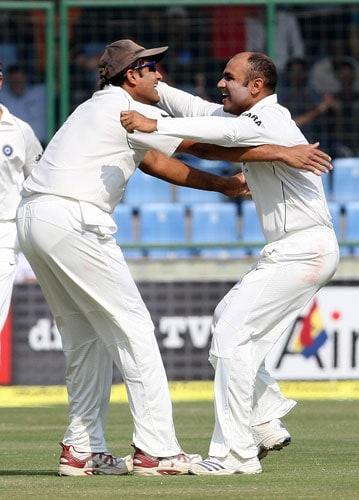 Anil Kumble hugs Virendra Sehwag after he took the wicket of Shane Watson during the third Test between India and Australia in New Delhi.