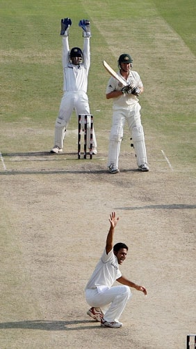 Anil Kumble and Mahendra Singh Dhoni successfully appeals for a LBW decision against Brett Lee during the third Test between India and Australia in New Delhi.