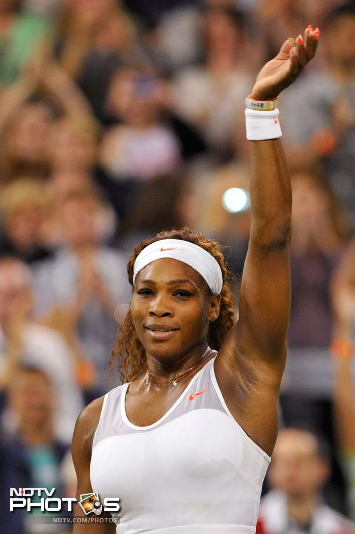 Top seed and defending champion Serena Williams breezed into the Wimbledon fourth round with a 6-2, 6-0 win over Japanese 42-year-old Kimiko Date-Krumm.