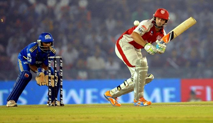 Kings XI Punjab captain Adam Gilchrist plays a shot during the IPL Twenty20 cricket against Mumbai Indians at the Punjab Cricket Association Stadium in Mohali. (AFP PHOTO)