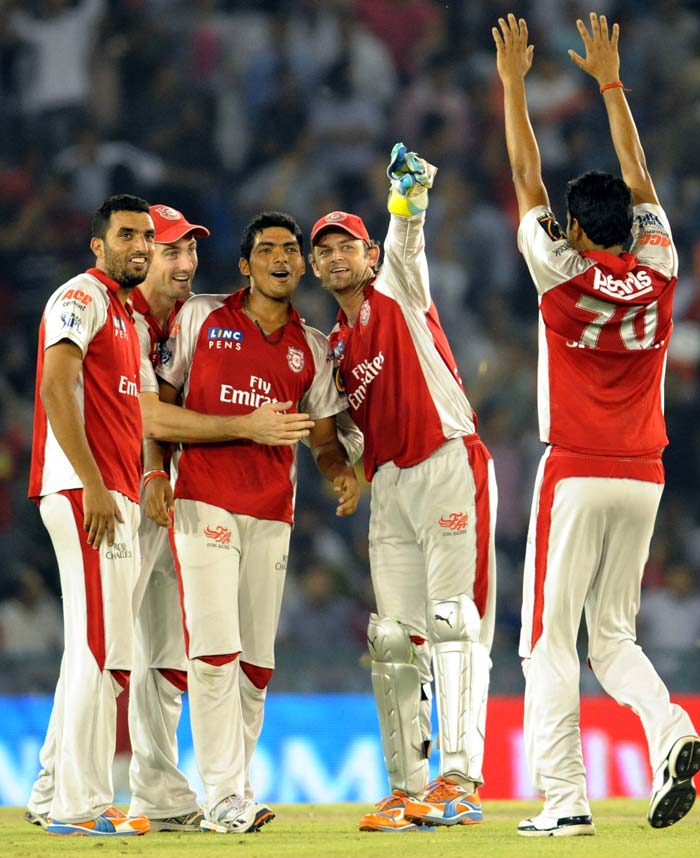 Kings XI Punjab captain Adam Gilchrist (2nd R) and Bhargav Bhatt (C) celebrate their victory against Mumbai Indians during the IPL Twenty20 cricket match at the Punjab Cricket Association Stadium in Mohali. Bhatt took four wickets and Kings XI Punjab won by 76 runs. (AFP Photo)