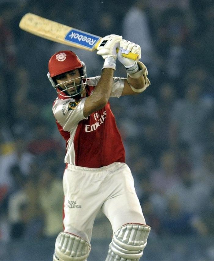 Kings XI Punjab batsman Dinesh Karthik plays a shot during the IPL Twenty20 cricket match against Mumbai Indians at the Punjab Cricket Association Stadium in Mohali. (AFP PHOTO)