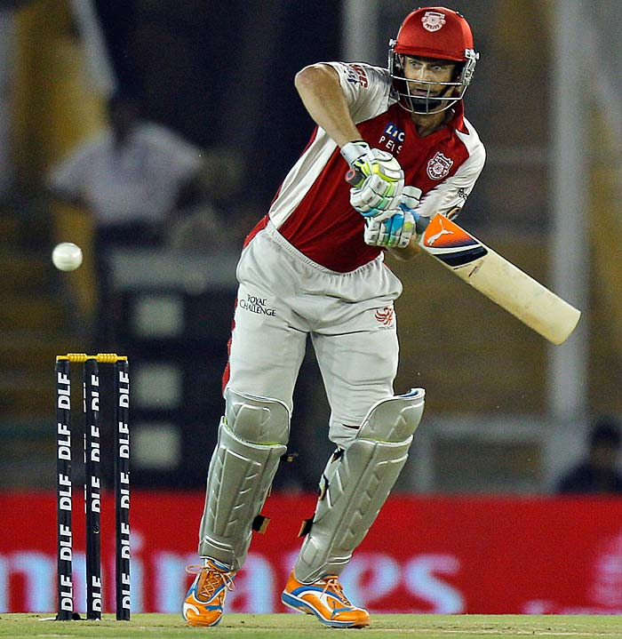 Kings XI Punjab captain Adam Gilchrist plays a stroke during the IPL Twenty20 cricket match against Pune Warriors at the Punjab Cricket Association Stadium in Mohali. (AP PHOTO)