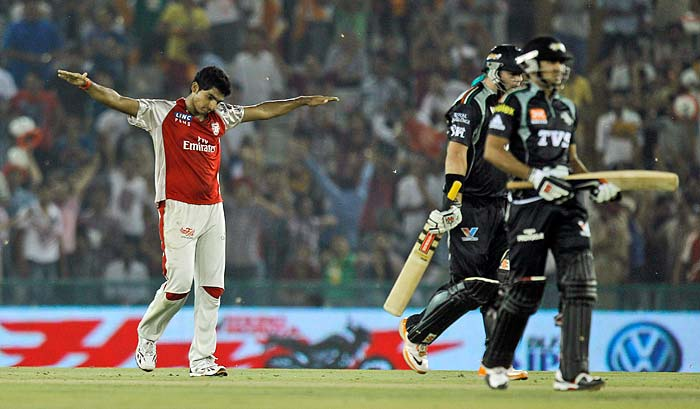 Kings XI Punjab's Bhargav Bhatt is jubilant after claiming the wicket of Pune Warriors' Jesse Ryder during the IPL Twenty20 cricket match at the Punjab Cricket Association Stadium in Mohali. (AP PHOTO)