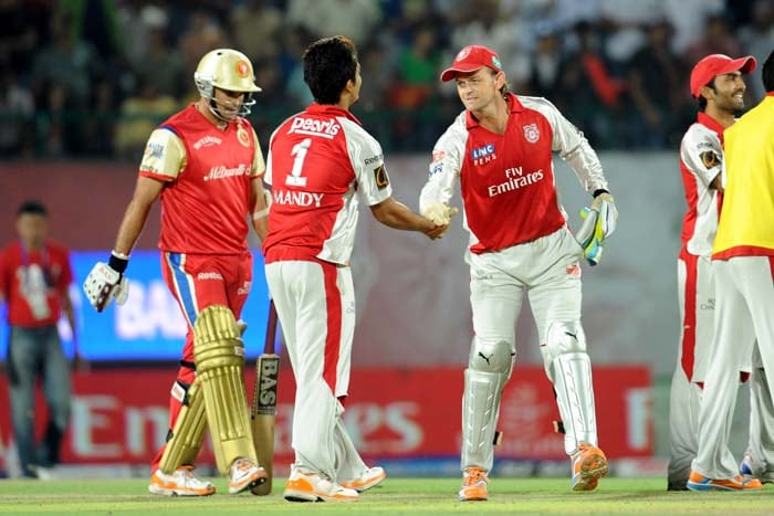 Kings XI Punjab captain Adam Gilchrist (R) celebrates the team's victory with his teammates during during the IPL Twenty20 cricket match at the Himachal Pradesh Cricket Association stadium in Dharamsala. Kings XI Punjab won the match by 111 Runs. (AFP PHOTO)