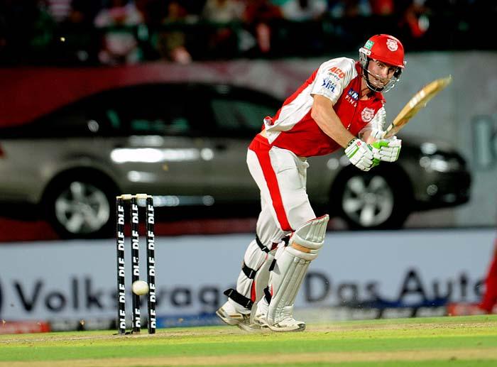 Kings XI Punjab batsman Shaun Marsh hits a shot during the IPL Twenty20 cricket match against Royal Challengers Bangalore at the Himachal Pradesh Cricket Association stadium in Dharamsala. (AFP PHOTO)