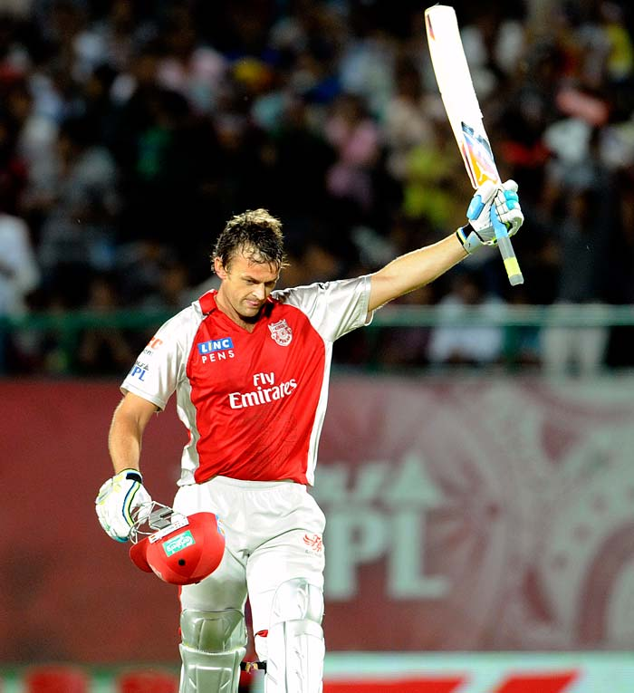 Kings XI Punjab captain Adam Gilchrist waves his bat after his century (during the IPL Twenty20 cricket match against Royal Challengers Bangalore at the Himachal Pradesh Cricket Association stadium in Dharamsala. (AFP PHOTO)