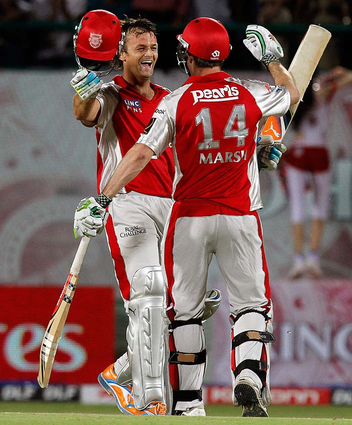 Kings XI Punjab captain Adam Gilchrist is congratulated by teammate Shaun Marsh after scoring a ton during the IPL Twenty20 cricket match against Royal Challengers Bangalore at the Himachal Pradesh Cricket Association stadium in Dharamsala. (AP PHOTO)