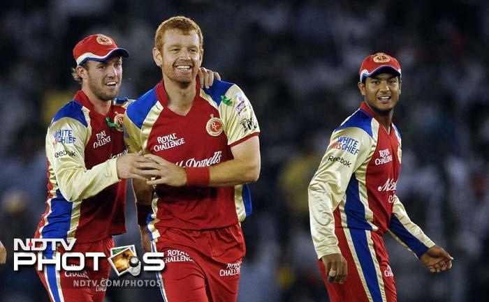 Royal Challengers Bangalore player Andrew McDonald (C) celebrates the wicket of Kings XI Punjab batsman Shaun Marsh with teammates during the IPL Twenty20 cricket match at PCA Stadium in Mohali. (AFP PHOTO/Prakash SINGH)