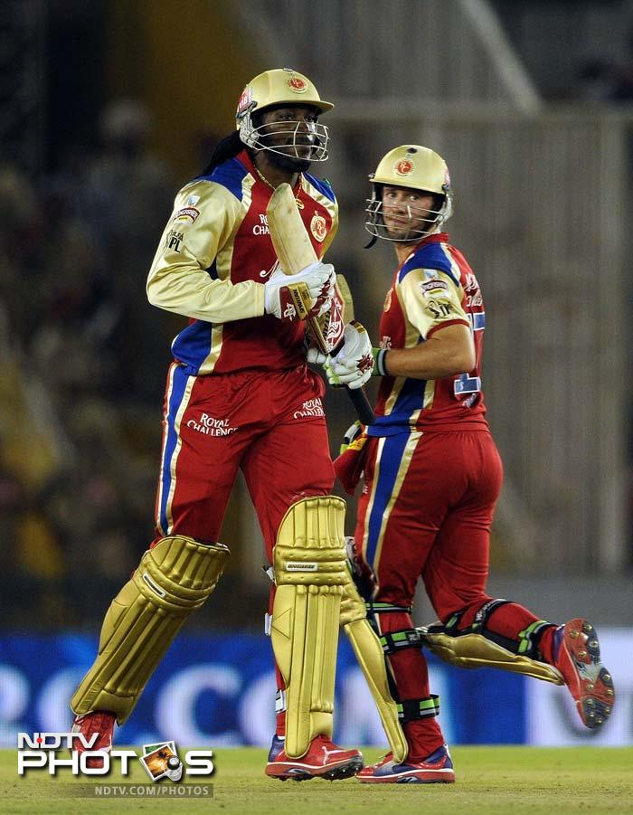 Chris Gayle (87 off 56) and AB de Villiers (52 off 39) helped Bangalore to recover from a poor start and beat Kings XI Punjab by 5 wickets. (AFP PHOTO/Prakash SINGH)