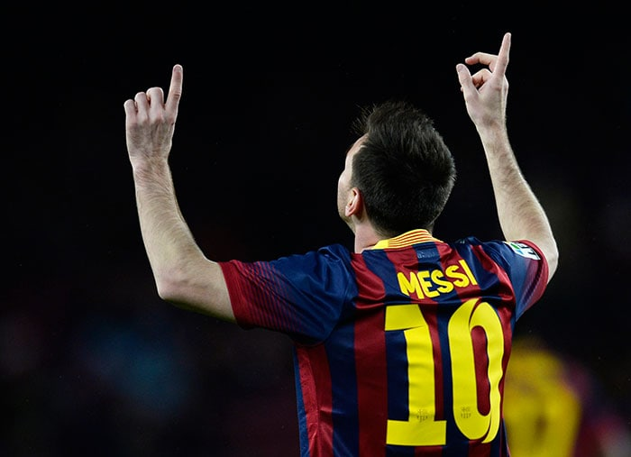 Lionel Messi (in pic) and Neymar helped Barcelona stay one point behind Atletico as it rose into second place.