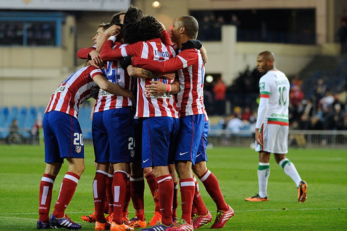 The problem for Real was compounded with wins by Atletico and Barcelona. <br><br>Atletico players are seen celebrating their 1-0 win over Granada. <br><br>The team moved three points clear of Madrid with eight rounds remaining.