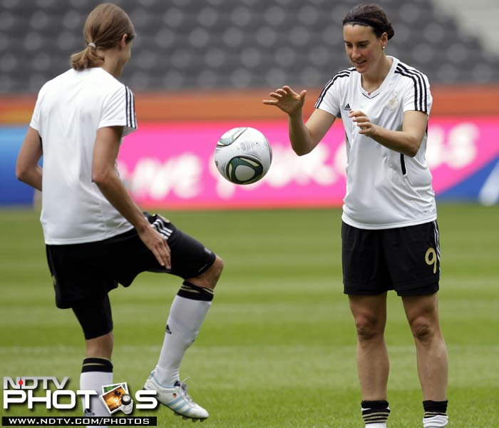 Training however is an important part of the schedule as well. Germany's Birgit Prinz, right, and Kerstin Garefrekes are seen in a practice session. (AP Photo)