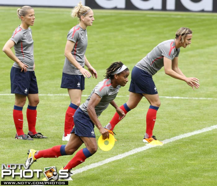 Players of France's women's soccer team run during their training session. (AP Photo)