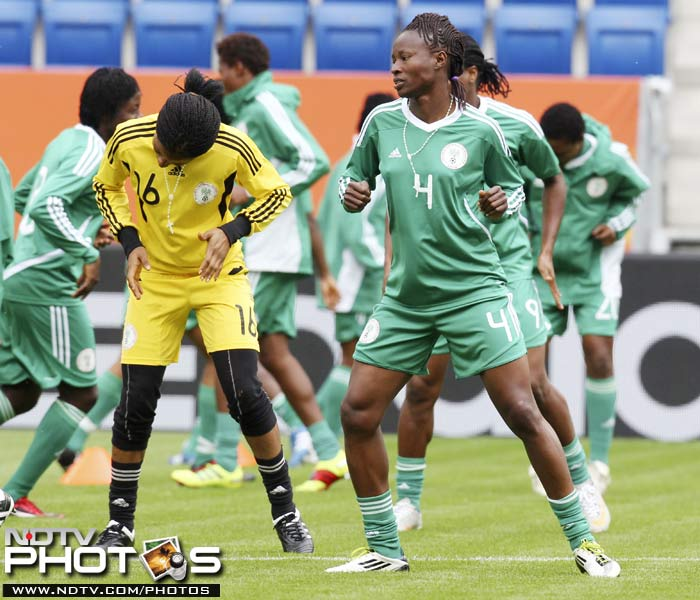 Players of Nigeria's women's soccer team Perpetua Nkwocha, right, and Tochukwu Oluehi warm up with team mates. (AP Photo)