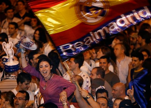 Real Madrid supporters celebrate at Cibeles square that their soccer team won the Spanish league title in Madrid, Monday, June 18, 2007. Real Madrid won their 30th Spanish League title.