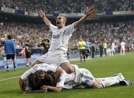 Real Madrid player Fabio Cannavaro celebrates the goal of his teammate Mahamadou Diarra during the Spanish League soccer match against Mallorca in Madrid.