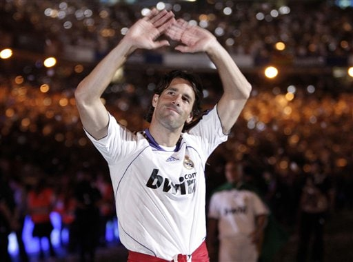 Real Madrid player Ruud Van Nistelrooy celebrates waving to his fans after his Spanish League soccer match against Mallorca in Madrid.