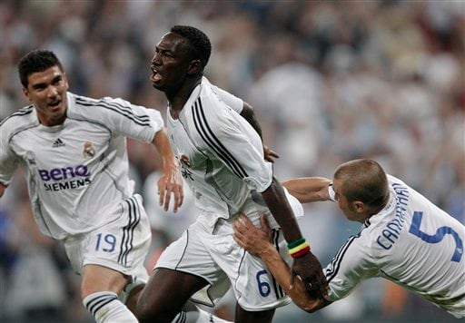 Real Madrid player Mahamadou Diarra, center, celebrates his goal with his teammates Fabio Cannavaro, right, and Jose Antonio Reyes during his Spanish League soccer match against Mallorca in Madrid.