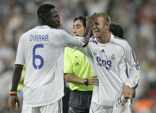 Real Madrid players Mahamadou Diarra, left, and David Beckham, right, celebrates after clinching the Spanish league Title after the soccer match against Mallorca in Madrid.