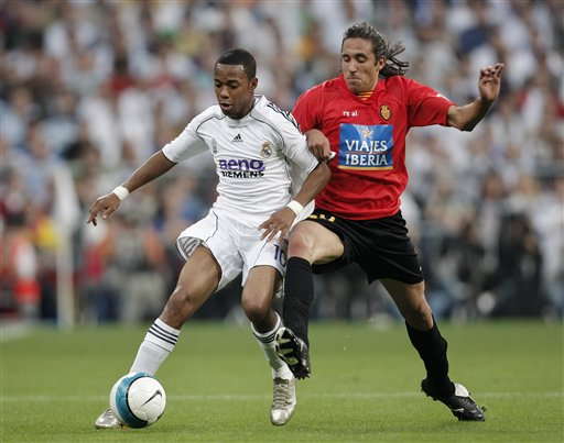 Real Madrid player Robinho, right, duels for the ball with Mallorca player Jonas Gutierrez during their Spanish League soccer match against Mallorca in Madrid.