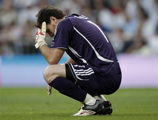Real Madrid goal keeper Iker Casillas reacts after Mallorca opened the scoring during the Spanish League soccer match against Mallorca in Madrid.