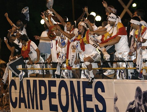 Real Madrid players celebrate on their bus at Cibeles square after winning Spanish league title in Madrid.