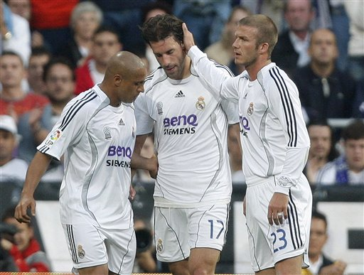 Real Madrid player Ruud Van Nistelrooy, center, gets comforted by his teammates David Beckham, right, and Roberto Carlos during the Spanish League soccer match against Mallorca in Madrid.