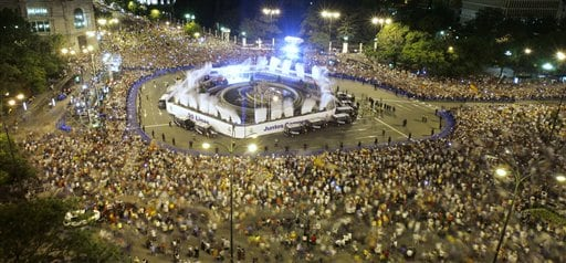 Supporters wait to their team at the Cibeles square after Real Madrid soccer team won the Spanish league title in Madrid.