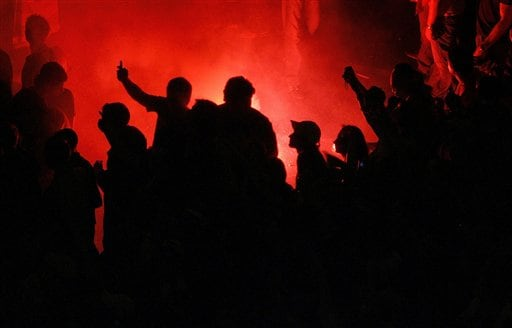 Real Madrid supporters celebrate at the Cibeles square that their soccer team won the Spanish league title in Madrid.