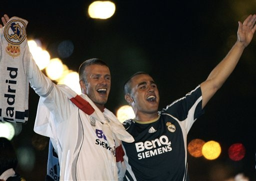 Real Madrid players David Beckham from England, left, and Fabio Cannavaro from Italy, right, celebrate on their bus at Cibeles square after winning Spanish league soccer title in Madrid.